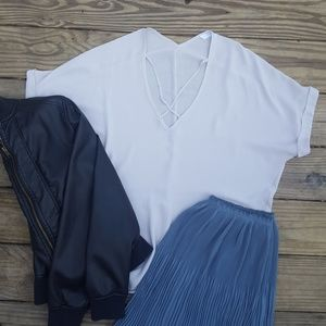 Very light silver/gray criss cross v-neck shirt
